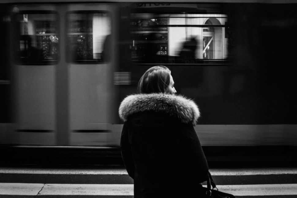 lady and tram moving by mono